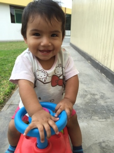Sandra (my favorite little lady) riding on the fire truck!